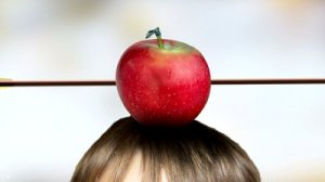 stock-footage-targeting-red-apple-on-head-hit-by-arrow-colorful-background-close-up-zoom-out-clip-id