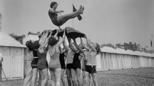 June 1930-Day trippers give the bumps to the birthday girl at Brighton seaside resort in East Sussex-Fox Photos-Getty Images