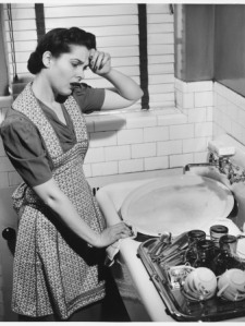george-marks-tired-woman-at-kitchen-sink-b-w-elevated-view