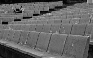 man-sitting-alone-with-his-laptop-in-an-ampitheater-black-and-white-by-500px