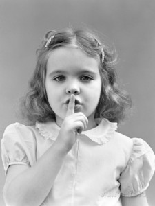 1940s-1950s-girl-with-finger-to-lips-making-quiet-shush-gesture