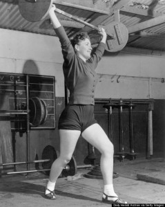 Woman lifting weights, 29 February 1956.