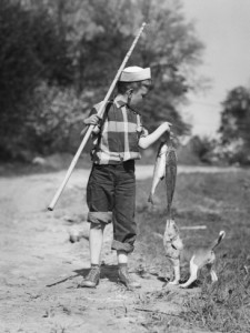 1950s-boy-plaid-shirt-sailor-hat-fishing-pole-dog-pulling-on-tail-of-caught-fish