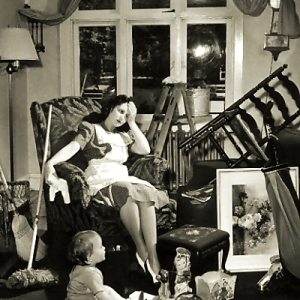 vintage-photo-of-an-exhasted-mother-and-child-in-a-cluttered-room